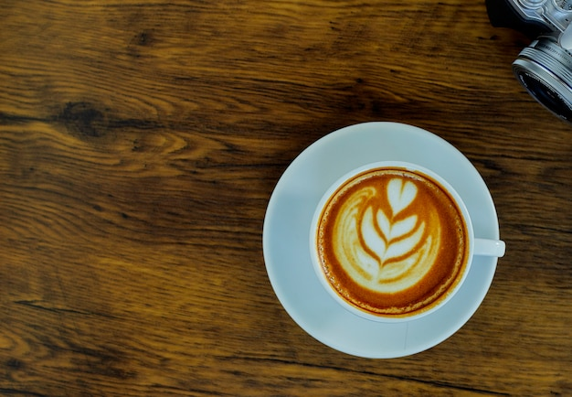 High angle cappuccino on wooden table
