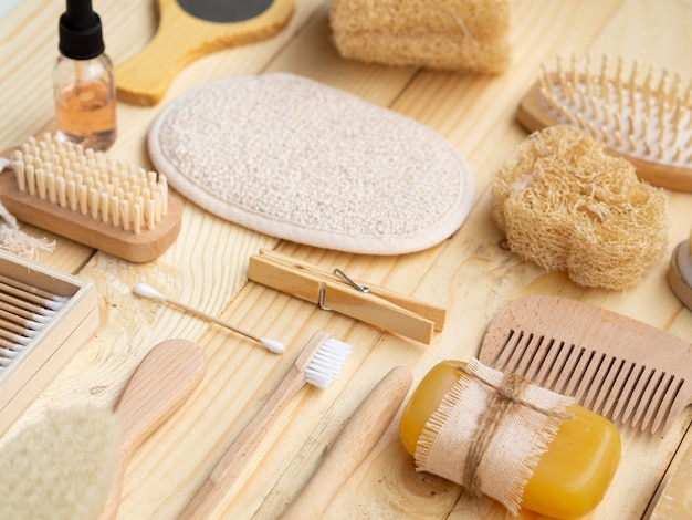 High angle care products on wooden background