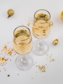 High angle of champagne glasses with golden glitter