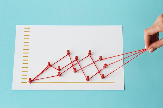High angle of chart statistics presentation with hand