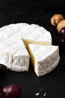High angle cheese composition on black background