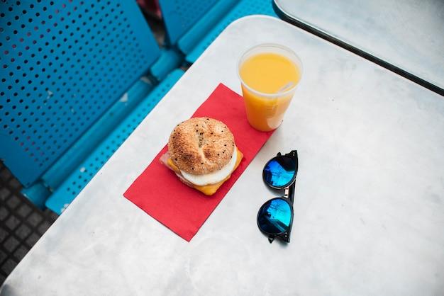 High angle cheeseburger and juice arrangement
