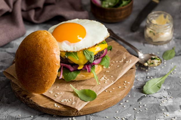 High angle cheeseburger with fried egg