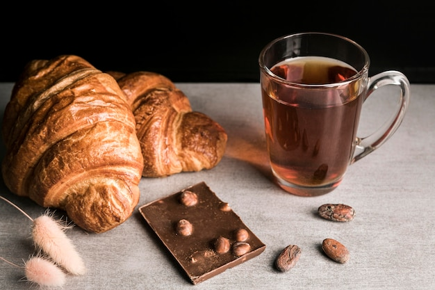 High angle chocolate bar and croissants with beverage