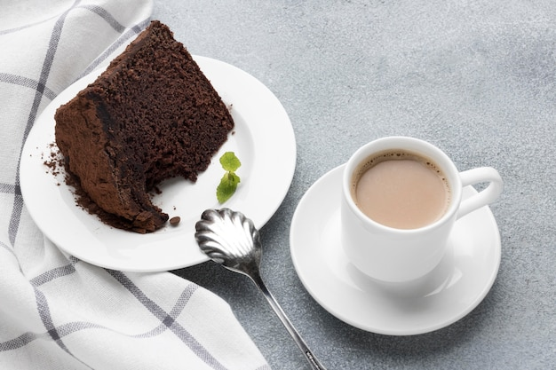 High angle of chocolate cake slice with coffee