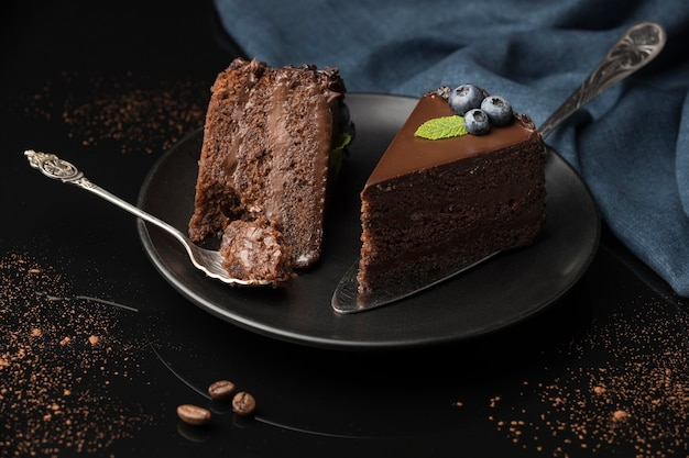 High angle of chocolate cake slices with spoon