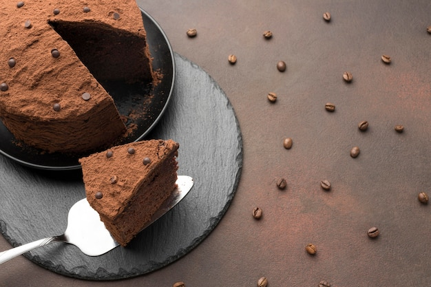 High angle of chocolate cake with coffee beans