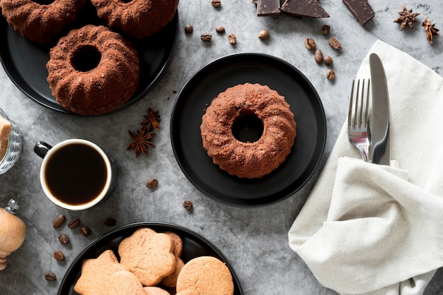 High angle chocolate cake with cookies and coffee