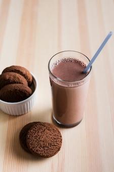 High angle chocolate milk with cookies