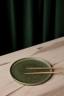 High angle of chopsticks on plate