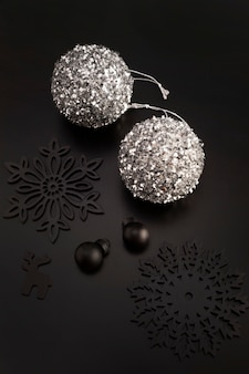 High angle of christmas globes with ornaments