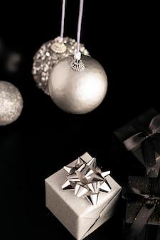 High angle of christmas globes with presents