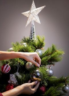 High angle christmas tree decorating time