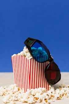 High angle cinema glasses and popcorn