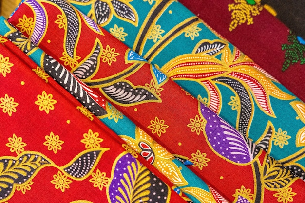 High angle closeup shot of colorful textiles with beautiful asian patterns