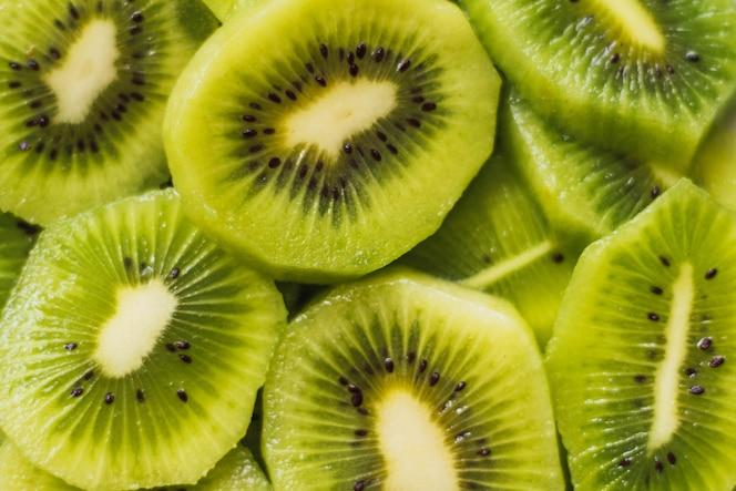 High angle closeup shot of delicious sliced kiwi fruits