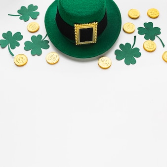 High angle clovers, hat and coins