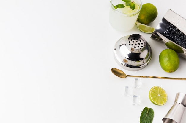 High angle of cocktail essentials with lime and copy space