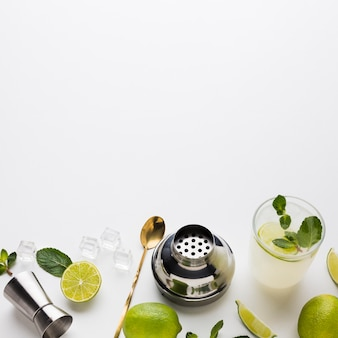 High angle of cocktail essentials with lime and mint