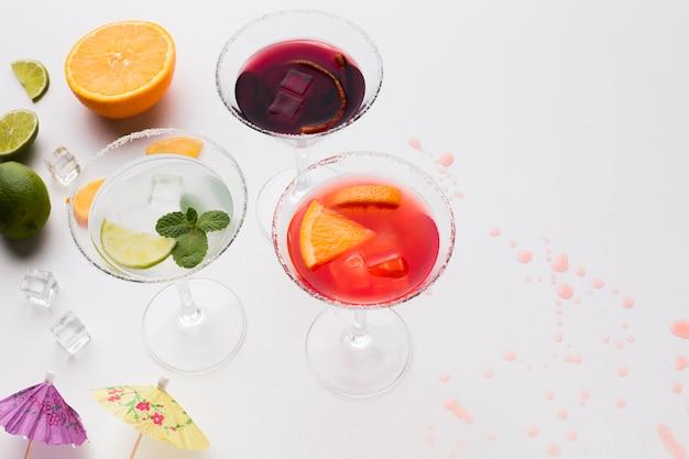 High angle of cocktail glasses with salt rim and lime