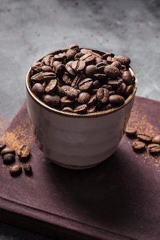 High angle coffee beans in cup