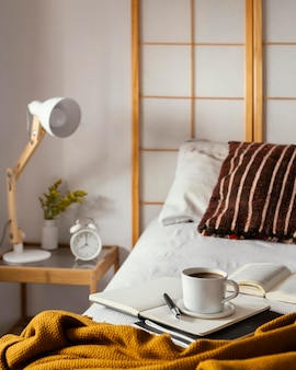 High angle coffee cup on bed