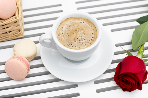 High angle of coffee cup and rose for valentines day