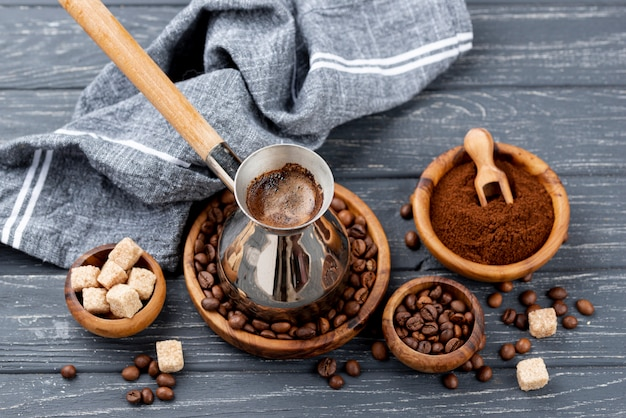 High angle of coffee on wooden table