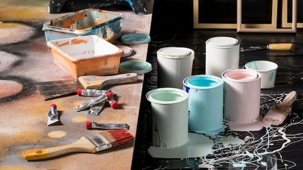 High angle of colored paint cans in studio
