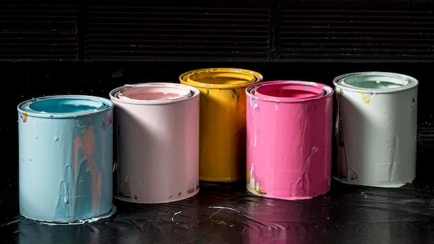 High angle of colored paint cans