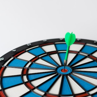 High angle of colorful dart stuck in bull's-eye