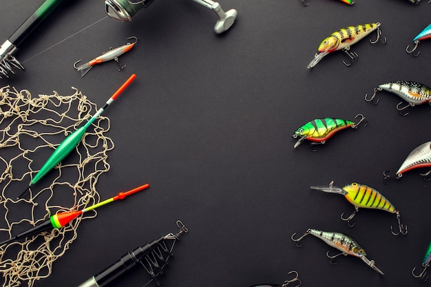 High angle of colorful fishing bait with net