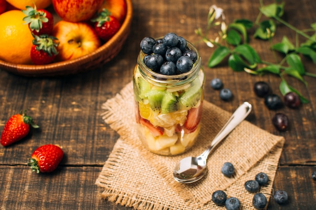 High angle colorful fruits in a jar