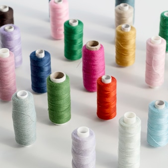High angle of colorful thread rolls