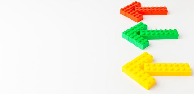 High angle of colorful toy arrows with copy space