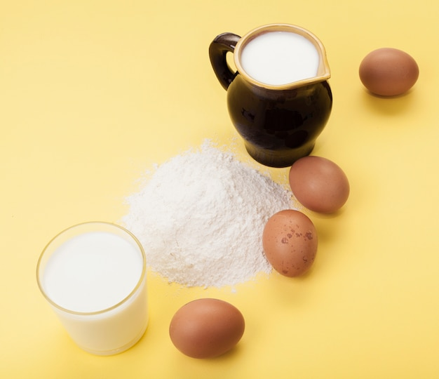 High angle composition of different ingredients on yellow background