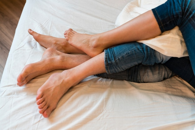High angle of couple feet in bed