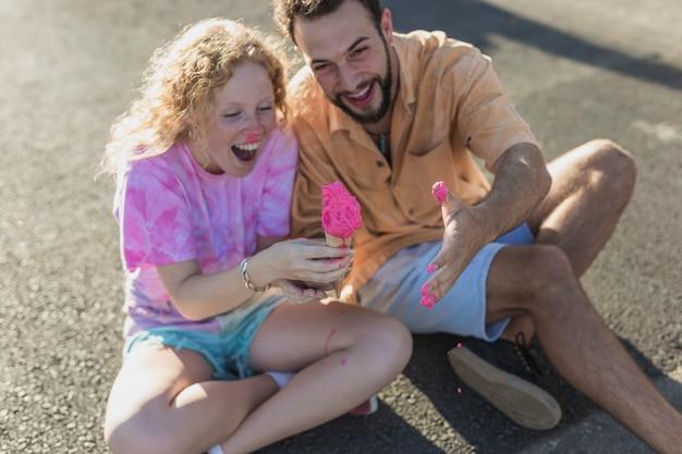 High angle couple having fun with ice cream