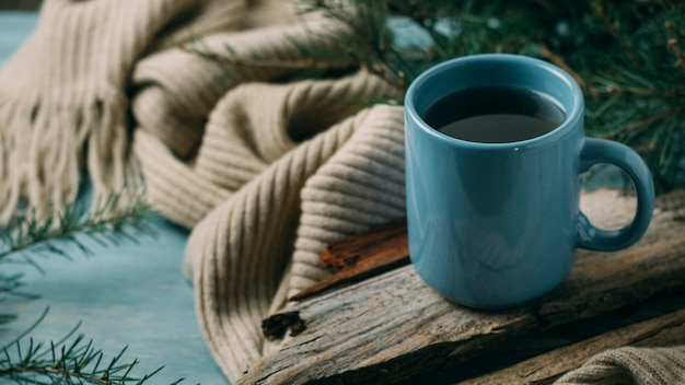 High angle cozy arrangement with scarf and mug