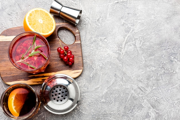 High angle cranberry vodka on cutting board with copy-space