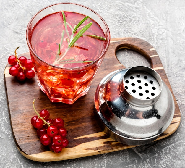 High angle cranberry vodka on cutting board