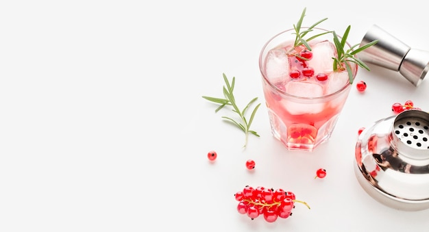 High angle cranberry vodka and shaker with copy-space
