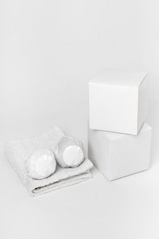 High angle creative assortment of packaged bath bombs and boxes