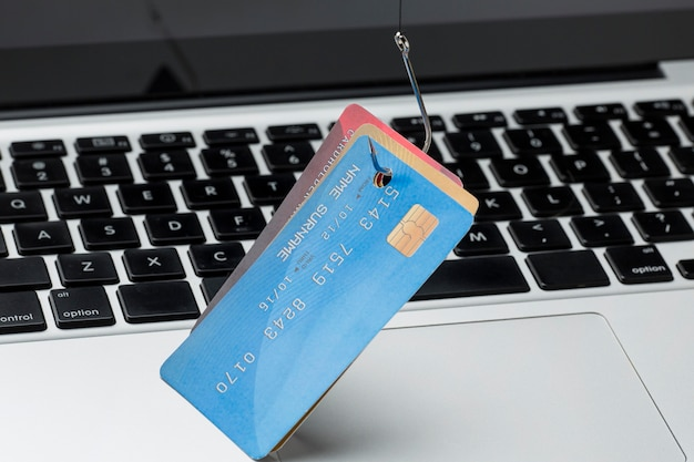 High angle of credit card with hook for phishing