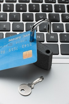 High angle of credit card with lock and key