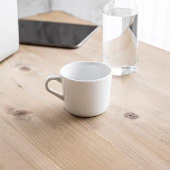 High angle cup and glass on table