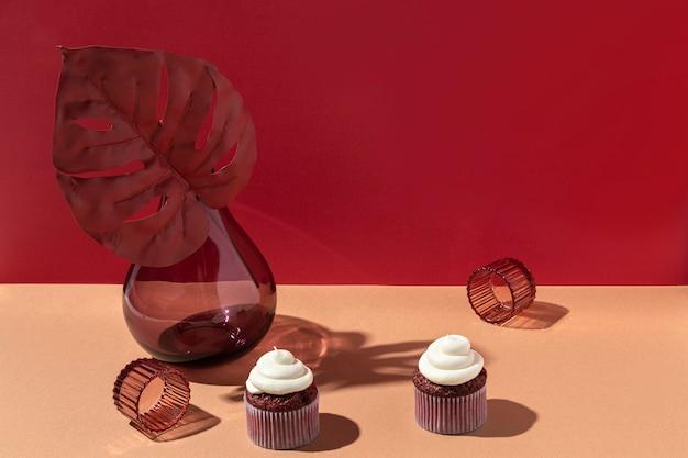 High angle cupcake and flower vase