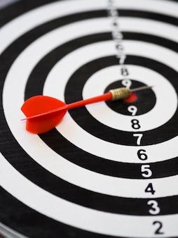 High angle of dart on top of dart board