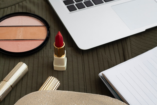 High angle decoration with red lipstick and laptop