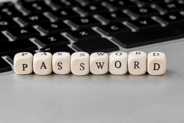 High angle of defocused wooden cubes with password on laptop